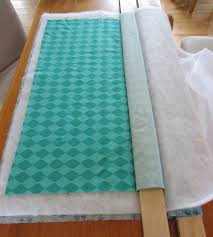 Color Me Quilty: Board Basting? & Now, both the top and the bottom of the quilt are wrapped around the two  1