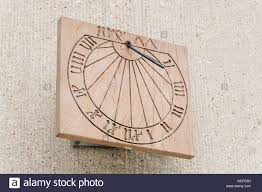 Wall Sundial Design Old Fashioned Wooden Sundial Clock On A Concrete Wall Of A