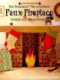 this cardboard faux fireplace is an easy solution for hanging stockings when you don t