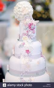 Fancy Delicious White Wedding Cake Decorated With Flowers And