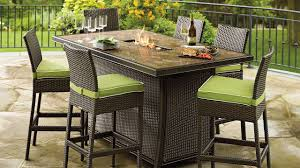 Stainless Steel Outdoor Dining Table Rattan Garden Furniture With Black Cushions Waterproof Cushions