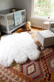 gray boys nursery with layered rugs