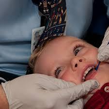 Image result for CHILD dental varnish