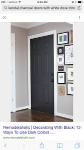 Door Color: Black Suede by Behr / --Satin finish with primer built in. They  didn't sand before painting because it was latex on latex.