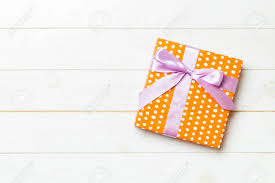 Beautiful Gift Box Design Beautiful Gift Box With A Colored Bow On The White Wooden Table