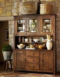 kitchen furniture hutch. stone wall behind rustic cabinet pottery barn catalog kitchen furniture hutch