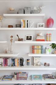 Ikea LACK shelving. I love the staggered shelves here. Thinking maybe put  the fabric