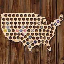 usa shaped plywood with empty beer cap shaped holes