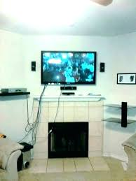 how to mount tv over fireplace and hide wires hide wires on wall s mounted over