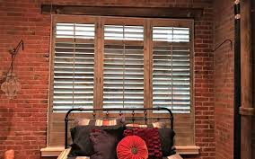 repurposed wood shutters in houston bedroom