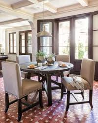 jaxon 5 piece round dining set this dining room set offers the rustic charm of solid pine and neutral upholstered dining chairs with nailhead trim