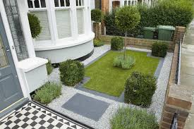 neat modern front garden with lawn and gravel