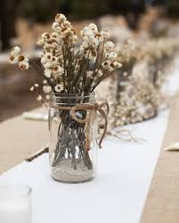 Casual Centerpiece- Cream and white dried ammobiums are set in Mason jars  that are tied