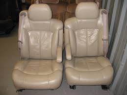 dual 6way power reclining lumbar heated leather seats colors tan dark gray shale lt gray armrests are on the seat comes with lid type console but will
