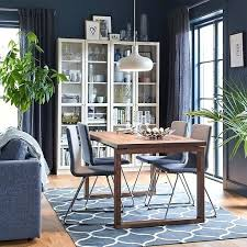 ikea round table and chairs a brown and grey dining setting with four comfortable upholstered chairs