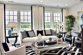 black white and blue shape a refined family room with mirrored coffee table design