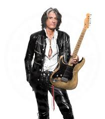 guitarist joe perry of the rock band aerosmith wears a lost art black leather jacket