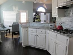 delivered dark floors white cabinets result laminate wood kitchen cabinet and flooring ideas townhouse soft options