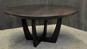 a round expanding dining table with a leaf