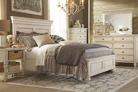 distressed vintage look on this queen panel bed and bedroom