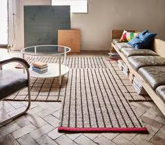 the tilst rug is a small runner that s handwoven in sisal and jute making it durable and with natural colour variations coloured bands break up the