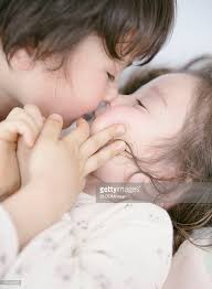 Awesome Canadian Girl And Boy Kissing With Lying Down On Bed : Stock Photo
