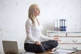 meditation office. Portrait Of Young Office Woman Sitting Cross-legged In Half Lotus Yoga Pose At Workplace. Smiling Business Lady Meditating After Finishing Her Work \u2014 Photo Meditation