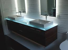 bathroom vanity with glass countertop and ceramic sinks