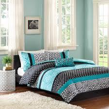 black white and turquoise animal print bedding