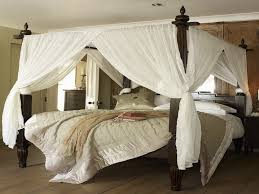 Comfortable Brown Wooden King Size Canopy Bed Frame With Large White ...