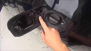 Cheap, easy fix for a broken spring on Gas cap Fuel Filler Door ...