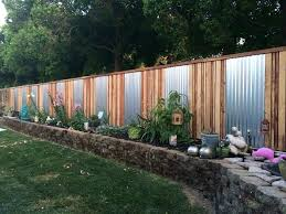 corrugated metal fence throughout and wood kerby co decorations 10