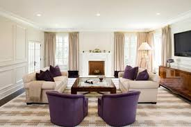 purple accents in this living room give it a controlled and calm atmosphere and silk hydrangeas are a lovely added touch