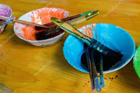 color bowl and brush water on wooden table stock photo ac hair dye mixing