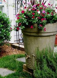 Better Homes and Gardens Bombay Decorative Planter  Red Sedona additionally  likewise Best 25  Mailbox planter ideas on Pinterest   Backyard trees moreover Decorations Fall Yard Decoration Ideas The Seasonal Home And besides 357 best Seasonal planters images on Pinterest   Gardens furthermore Best 25  Front porch planters ideas on Pinterest   Front porch also  moreover Decorative Planters And landscape traditional with garage door further 115 best Elements   Planters   Lightweight images on Pinterest together with Best 25  Decorative planters ideas on Pinterest   Garden pots also . on decorative yard planters
