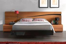 image of modern wooden beds with rug
