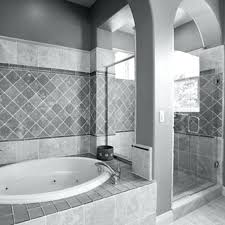bathroom flooring tiles alcove bathtub marble surrounded wooden vanity storage large blue whirlpool wall mount faucet