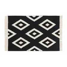 large rug in black and white diamonds