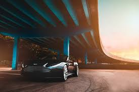 cool car wallpaper iphone. Interesting Cool Cool Wallpapers  Travel Black Aston Martin Convertible Coupe  Parked Beside Blue Concrete Bridge And Car Wallpaper Iphone 7