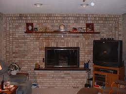 living room with brick fireplace and mantle decorations also fireplace hearths with tv stand and recliner plus side table with carpet floors and faux wall