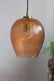 amber tinted glass pendant light with