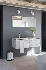 Vipp bathroom module, mirror, bin and spots. All white bathroom interior on  grey