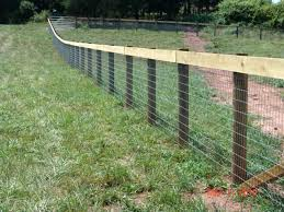 fence installation services cedar wood ornamental iron gates problems with uneven ground