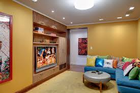 ... Bright L-shaped couch in blue with colorful accent pillows for the TV  room [