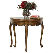 oak half round demilune vintage console opens to round game table signed baker