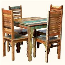 rustic reclaimed wood dining table w shutter back chairs for 4 people eclectic dining tables austin by sierra living concepts