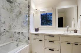 white bathroom cabinets with bronze hardware. vanity mirror, built in vanity, washstand, offset sink white bathroom cabinets with bronze hardware
