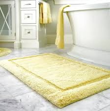 yellow and white bath rug