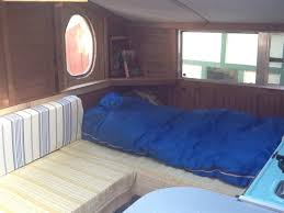 Sleeping-area-inside-a-small-RV