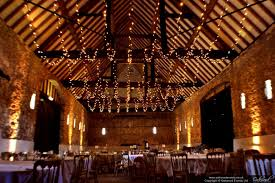 barn fairy light ceiling with gold uplighting